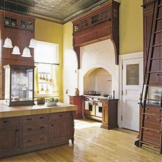 Floor-to-ceiling custom oak cabinetry and a massive island transform the mail-sorting area of a former Pennsylvania post office into a to-die-for kitchen. | Photograph: Michael Luppino | thisoldhouse.com