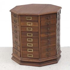 I just discovered this OAK OCTAGONAL REVOLVING BOLT CABINET on LiveAuctioneers and wanted to share it with you: www.liveauctioneers.com/item/31356858