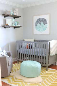 Loving this gender neutral nursery! That gray crib with the wood accents and pop of color is perfect for any baby! Such a cute idea for a gorgeous home space.