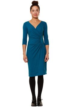Teal faux wrap dress in 95% organic Fairtrade certified cotton, 5% elastane. Faux wrap jersey dress with V-neck and 3/4 length sleeves. Also available in black and khaki. Length 101cm.