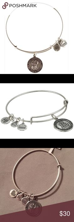 Alex and Ani Silver Saint Christopher Bracelet brand new with tag Alex and Ani Rafaelian Silver Saint Christopher adjustable bangle bracelet. Saint Christopher helped a child cross a river by bearing him on his back. Extraordinarily heavy, the child finally revealed himself as Jesus Christ who was carrying the weight of the world. Saint Christopher became the patron saint of travellers and a sacred source of protection. Saint Christopher Bracelet represents Strength, Protection, and Aid…
