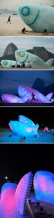 A fish sculpture constructed from discarded plastic bottles rises out of the sand at Botafogo beach in Rio de Janeiro.