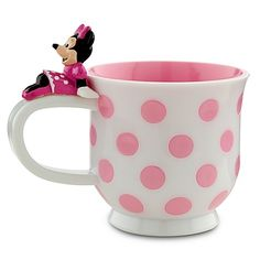 Minnie puts her feet up as she takes a rest on the handle of this Polka Dot Minnie Mouse Cup. Part of our Minnie Meal Time Magic Collection and made of durable acrylic, this cup features Minnie's trademark polka dots in bright pink that match the inside..