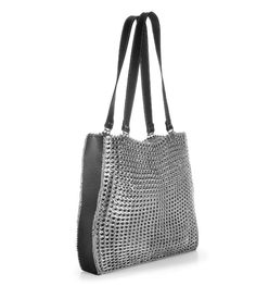 """Circular handheld purse is a magnet for attention. Lined with silver monogrammed fabric. Metal zipper closure. One inside zipped pocket. Size: 9.5"""" diameter x 1.5"""" W x 3.5"""" handle Thread color: silver"""