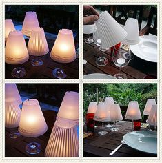 Wineglasses holding candles and topped with small shades, cute idea for the dinner table.