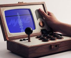 Boredom will be the last thing on the agenda the next time you travel with the portable arcade console emulator. Encased in a distinguished wooden frame, once opened this retro styled console shines by offering you the chance to play classic arcade games.
