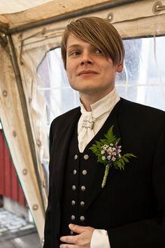 An Icelandic man wears the hátíðarbúningur formal costume on his wedding day along with a boutonnière.
