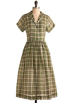 Green plaid shirt-dress, c. 1960s. This dress would likely have had a matching self-fabric belt, but it has since been lost.
