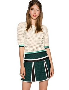 """Inject some sporty vibe in your wardrobe with this super cool ivory knit top. It has varsity stripes in black, white, and green on sleeves and hemline. Mesh net structure, unlined. This stylish varsity knit top is a must-have to transition into fall. We recommend styling it with a flared skirt and lace-up platform shoes. *100% polyester*32""""/81cm bust*19.5""""/49.5cm length*Measurements are taken from size small.*Model is wearing size small and model's height is 5'8.5""""/174cm."""