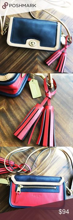 """Coach Legacy Penny Crossbody Absolutely beautiful Authentic Coach Legacy Penny Crossbody, with no flaws or defects; excellent condition. The Penny Shoulder Purse gets a pretty, modern update in three-tone leather with striking contrast trim. It has 2 gorgeous legacy tassels are attached. gold metal hardware and it's in a beautiful navy, cream and red color. Less on Ⓜ️ercari   Features 7 3/4"""" (L) x 5"""" (H) x 2 1/4"""" (W) Double strap for shoulder or crossbody wear Turnlock closure, fabric lining…"""