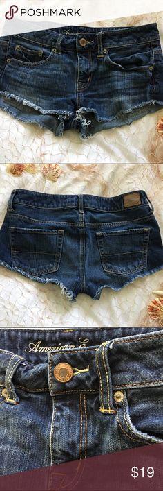 "American Eagle booty shorts denim cut offs American Eagle Outfitters denim cut offs, booty shorts, 100% cotton, women's sz 4 waist = 32"" rise = 8"" inseam = 2"" in excellent condition. American Eagle Outfitters Shorts Jean Shorts"