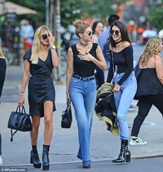 Added extras:The 21-year-old wore flared jeans with a raw edge and added a Hermes belt, Ray Ban sunglasses and a pair of black mules