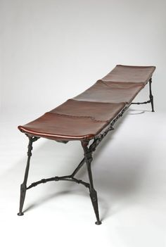 Unique and antique bench. FRANCOIS THEVENAN WROUGHT IRON AND LEATHER BENCH