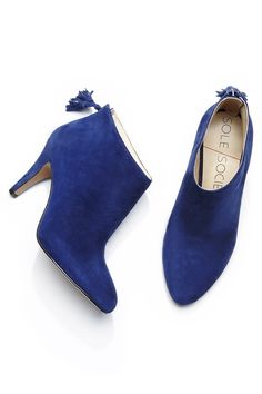 blue suede heeled booties with swingy tassels at the back zippers