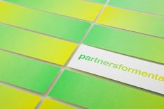 Partners for Mental Health business card with yellow and green fluorescent ink detail designed by Blok.