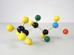 Must have a molecular model. I like that this one is wood.