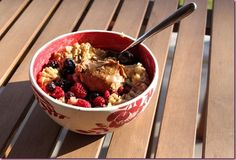 Protein oats (1 cup oats cooked with frozen mixed berries, Sun Warrior and topped with a blob of almond butter)