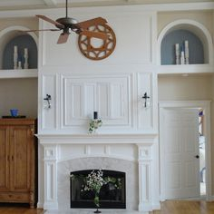 This husband-and-wife team of DIYers transformed a blank wall with a richly detailed mantle and built-in TV cabinet above. | thisoldhouse.com/yourTOH