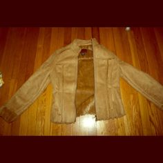 Calvin Klein Jeans suede tan jacket. So soft! this super soft suede and lining is something you owe yourself! The multi-season tan makes it perfect for those unusually cold spring and fall days. This like new jacket is adorable. Make me an offer. Calvin Klein Jackets & Coats