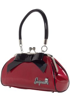 """The Floozy Purse is now available in gorgeous, red, textured vinyl! And with an upgraded vinyl comes an upgraded name... meet our SUPER Floozy Purse! We've kept the classic style, with its signature black """"Floozy"""" bow and Sourpuss metal logo, inner, black satin lining and inner, zippered pocket....."""