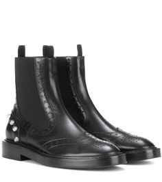BALENCIAGA - Embellished leather Chelsea boots - Balenciaga's tough-luxe take on the classic Chelsea boot is what makes this pair an essential for urban style during the colder months. The polished black leather is finished with brogue detailing and shiny silver-tone studs for a pop of contrast. Wear yours with soft cashmere sweaters for a rebellious finish. @ www.mytheresa.com
