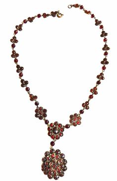 Victorian late 1800s Bohemian Garnet flower necklace, 2 panels on either side, a center flower , and then a hanging pendant with garnets. These are