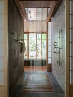 Love that you can walk in from both sides. The Rain shower is awesome and the wooden slats on the shower floor is a nice idea. But woud it hold up?? Contemporary Spa Bathroom: CTA Architects