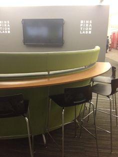 high desks around semi circular high back seats VPL Main branch
