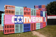 Stacked multi-colored and branded pallets for an entrance, backdrop or anything . - - Stacked multi-colored and branded pallets for an entrance, backdrop or anything you can imagine! Bühnen Design, Booth Design, Event Design, Event Signage, Event Branding, Environmental Graphics, Environmental Design, Decoration Evenementielle, Architecture Restaurant