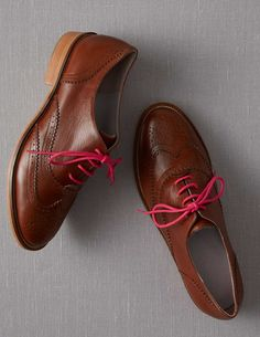 Cute. I love the unexpected pop of pink in the laces!