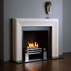 The Chelsea is a contemporary design which re-invents the traditional bolection shape in an elegant minimalist form by refining the design into a single graceful sweeping moulding.  The Chelsea is shown in Bianco Avorio limestone with the Universal fire basket for dogs and Spherical Steel fire dogs.  DETAILS Opening 37 1/4'' (947mm) W x 33 7/8'' (861mm) H Shelf