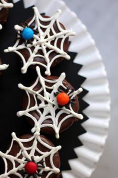 Easy to make 'spiders' and 'webs' make any cupcakes Halloween-ready!