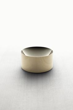 Solid brass dish from Minimalux. / Would be a cute nesting spot for everyday earrings and rings.