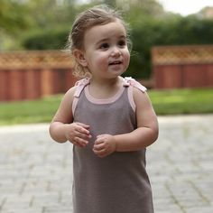 The sun is out! Time for some gardening! Love our Azalea dress on this little one!