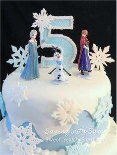 Frozen Birthday Cake with Sparkly number topper. Elsa, Anna and Olaf and hand cut snowflakes. Frozen Cake Topper