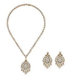 Comprising a necklace, suspending a detachable circular-cut diamond cluster pendant, to the circular-cut diamond neckchain; and a pair of ear clips en suite, mounted in 18k gold, necklace 17½ ins., with French exportation marks and maker's marks, in two Van Cleef & Arpels beige and green pouches  Each signed V.C.A. for Van Cleef & Arpels