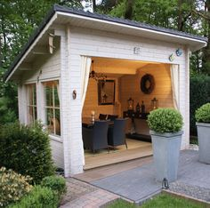 Like the garden house but am pinning for boxes, I have these, like boxwoods in them.  This garden house is gorgeous - would love to have one when I have a bigger garden.