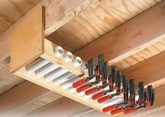 Garage Overhead Clamp Rack. Short lengths of PVC pipe held in the rack serve as compartments to store each clamp individually. By lining the pipes up side by side, have easy access to the exact size of clamp needed.