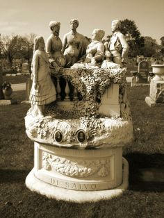 "Mount Carmel Cemetery, Hillside IL ~ The gravesite of Angelo (1869-1932) & Rosa (1872-1927) Di Salvo. ""Larosa"" ""Florence 1891"" are also on the base of the sculpture. Some believe this could be the name of the sculptor & where & when the piece was made. The sculpture can be rotated (quite easily) 360 degrees on it's base, & it does get rotated quite often."