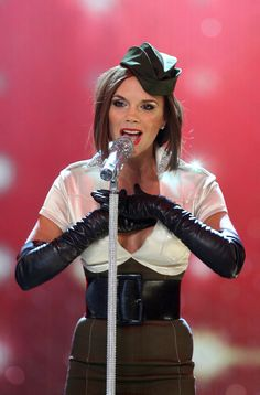 Celebrities in Gloves — Victoria Beckham wearing leather opera gloves.