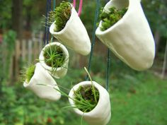 Love this idea that you can grow your garden right under your nose with these handmade necklaces.  You don't have to be restricted to just air plants anymore with this design.