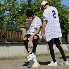 baseball shirt & black ripped skinnies.