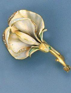 An Art Nouveau Enamel and Diamond-set Brooch  Designed as an orchid circa 1900, 4.5 cm long