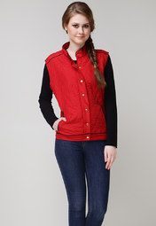 You don't need to compromise on style even during chilly winters with this red jacket from Sportelle USA*INDIA. The quilted pattern and stylish, front button opening will surely catch your attention at a single glance. Not to forget the black coloured detailing on pockets, collar, shoulders and hemline, which breaks the monotony of red.