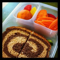 Pepperidge Farm swirled wheat bread. Roasted chicken with lettuce and cheese, clementine, two candy fruit slices, carrot chips and ranch on the side.