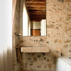 What do you think of some rustic harshness in your bathroom? (image via NY Times)