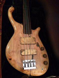 2013 Tom Martinson Custom Made  Fretless Nessie. All woods from Hawaii.