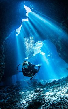 People Diving Underwater At Sea, Ocean, Cave. The sea is incredibly clear, which is ideal for snorkeling. Cave Diving is challenging sport and it is very dangerous and require top skills. Scuba Diving Tattoo, Scuba Diving Quotes, Best Scuba Diving, Scuba Diving Suit, Diving Logo, Under The Water, Under The Sea, Underwater Caves, Underwater Photos