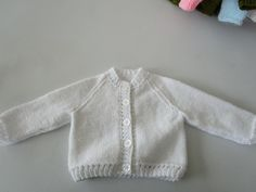 Our Knit & Natter Group created this beautiful white cardigan for sale!