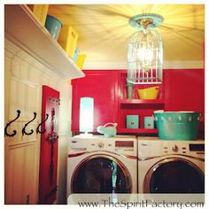 I am in love with this colorful laundry room